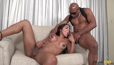 Sultry transsexual hottie Drika Lima is anal banged doggy at the end of one's tether black stud