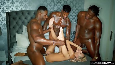 Three horny black guys are stretching one spoiled blonde cutie with their hard throbbing cocks