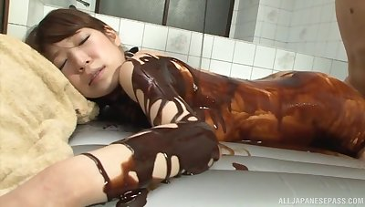 Naughty Asian girl massaging a hard load of shit with her firm boobs